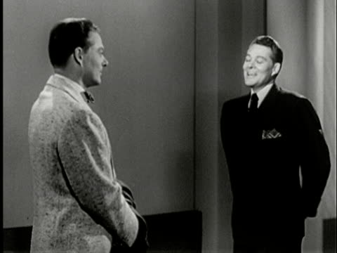 1952 B/W VS ZI to CU man smoking cigarette deep in thought, surreal scene with two men appearing in office played by same actor / man talking to himself about a business deal/ USA/ Audio
