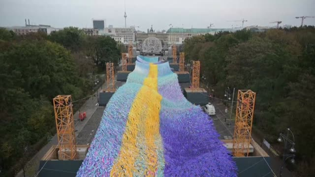to mark the 30th anniversary of the fall of the berlin wall american artist patrick shearn is completing a 150metrelong installation composed of... - artist stock videos & royalty-free footage
