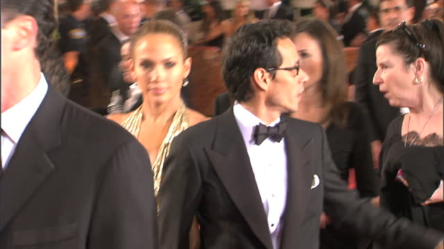 to mcu & pan with marc anthony & jennifer lopez as they walk in crowd waving to press as they call their names - 2009 stock videos & royalty-free footage