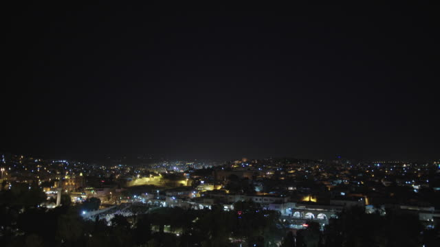 TILT DOWN to Middle East city at night