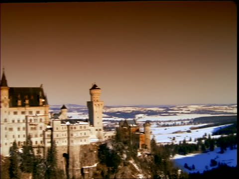 pan to neuschwanstein castle in winter / germany - cinematography stock videos & royalty-free footage