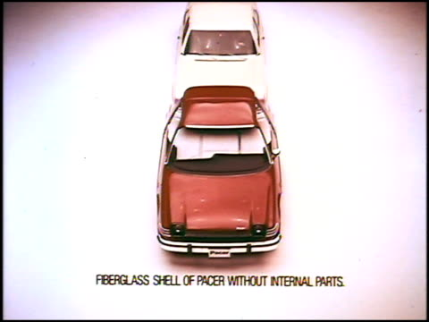 vídeos de stock, filmes e b-roll de to prove that the pacer was the world's first wide small car amc showed a '75 chevrolet nova driving directly into a shell of the pacer 1975 amc... - ford motor company