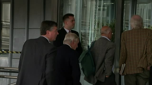 to review location of it's head office; london: people queuing to get into hsbc agm shareholders in queue vox pops - annual general meeting stock videos & royalty-free footage