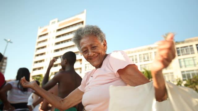 to samba music by Ipanema beach An elderly lady enjoys dancing at Ipanema Beach on February 01 2012 in Rio de Janeiro Brazil