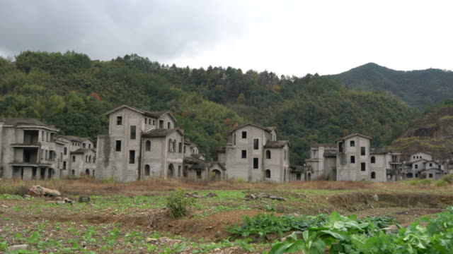 vídeos de stock, filmes e b-roll de to take up rural land and build holiday villas once a hot trend during the real estate bubble period finally turned out to be illegal overinvestment - imperfeição