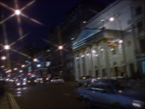 pan to theatre royal in haymarket at night / london - theatre royal haymarket stock videos & royalty-free footage