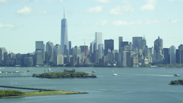 MEDIUM to WIDE Downtown Manhattan with Statue of Liberty