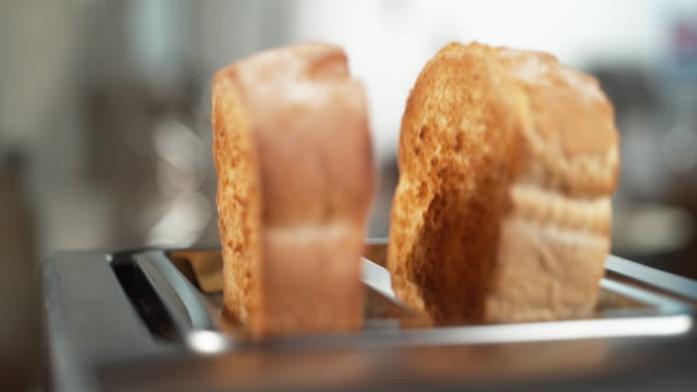 toast popping out of a toaster - toaster appliance stock videos & royalty-free footage