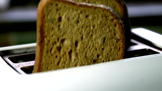 toast popping out of toaster in kitchen - toaster appliance stock videos & royalty-free footage