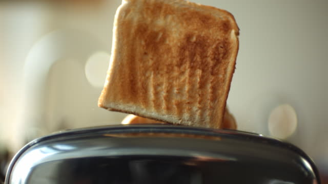 CU SLO MO Toast popping up from toaster / Manchester, United Kingdom