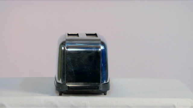 toast pops out of toaster - toaster appliance stock videos & royalty-free footage