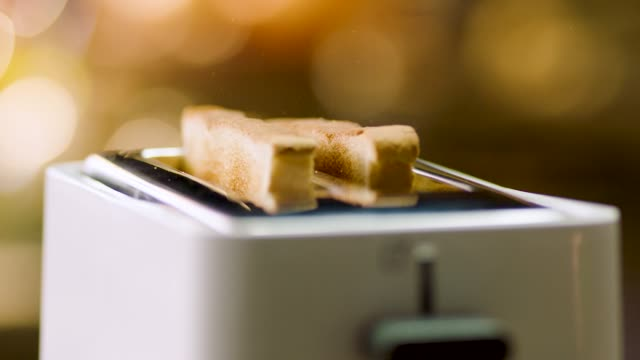 toast slices coming out from toaster in extreme slow motin in 4k resolution - toaster appliance stock videos & royalty-free footage