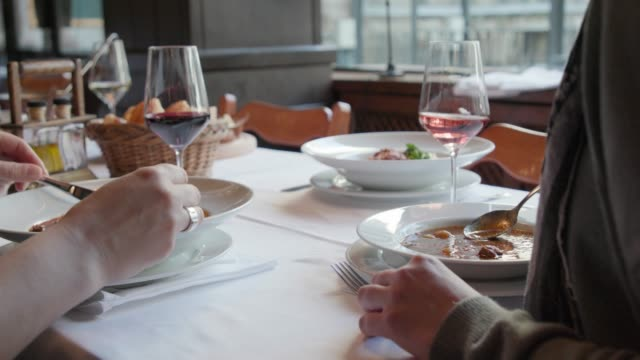 a toast with wine over lunch in a restaurant - table knife stock videos & royalty-free footage