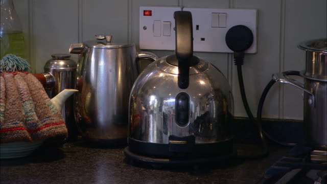a toaster and teapots sit on a kitchen counter. - toaster appliance stock videos & royalty-free footage