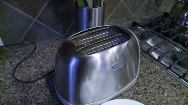 toaster used in pecan street inc house near austin texas - toaster appliance stock videos & royalty-free footage