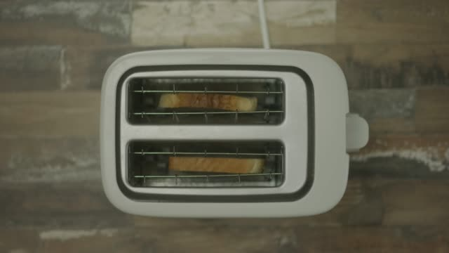 toasting bread - toaster appliance stock videos & royalty-free footage