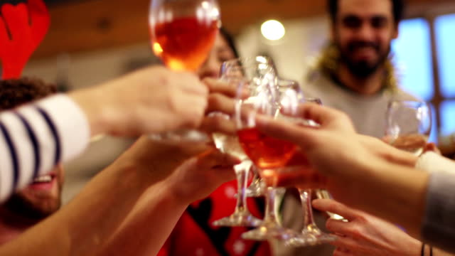 toasting to christmas - rose wine stock videos and b-roll footage