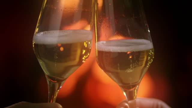 slo mo toasting with champagne by the fireplace - champagne stock videos & royalty-free footage