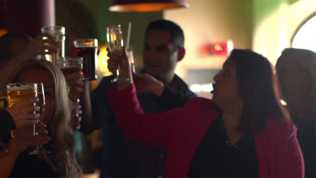 toasting young adults colleague party bar - colleague stock videos & royalty-free footage