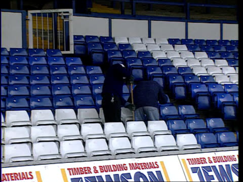 vídeos de stock, filmes e b-roll de tobacco smuggling lib luton two men sweeping between seats in stands pull out - smuggling