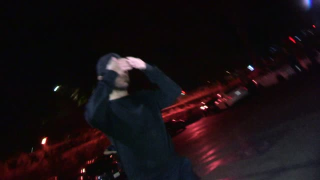 tobey maguire is camera shy while departing the drake vs lil wayne concert at the hollywood bowl in celebrity sightings in los angeles - tobey maguire stock videos and b-roll footage