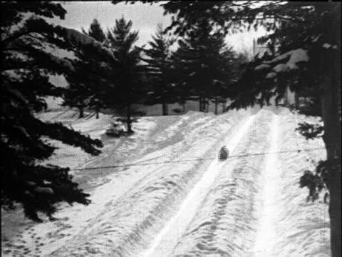 vidéos et rushes de b/w 1924 toboggan going down snow-covered mountain / lake placid / industrial - 1924
