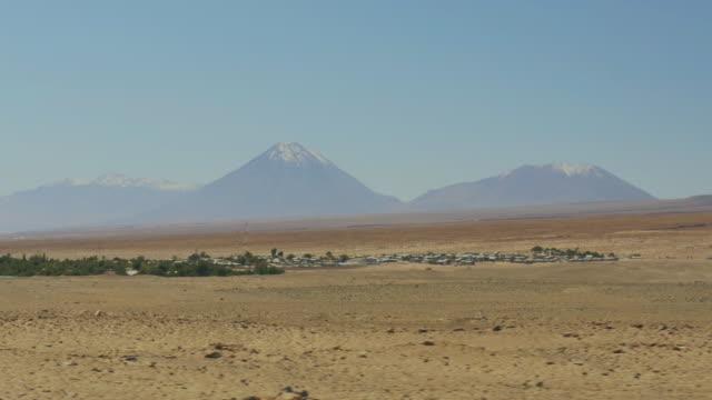 toconao village with the licancabur volcano in the distance - san pedro de atacama stock videos & royalty-free footage