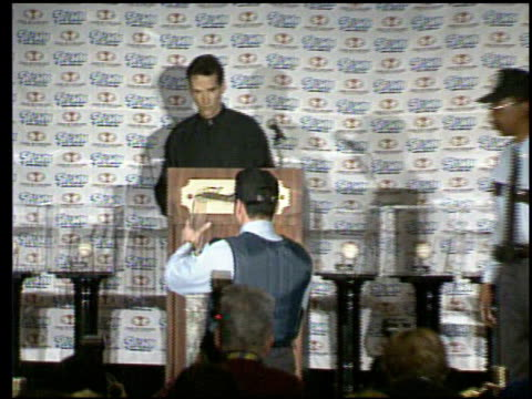 / todd mcfarlane bought mark mcgwire's 70th homerun ball / mcfarlane plans to put the 'mcfarlane collection' on display to help raise money for... - in front of点の映像素材/bロール
