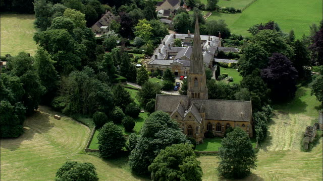 Toddington church - Aerial View - England,  Gloucestershire,  Tewkesbury helicopter filming,  aerial video,  cineflex,  establishing shot,  United Kingdom