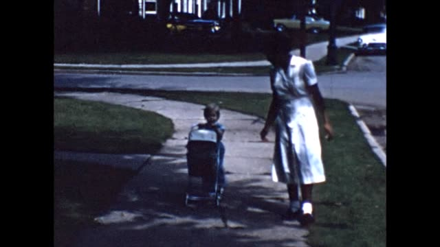 vidéos et rushes de 1956 toddler and african-american nanny with stroller - garde d'enfant