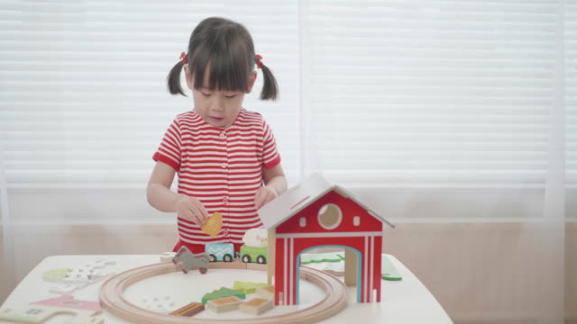 toddler baby girl play toy block at home - toy stock videos & royalty-free footage