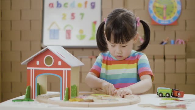toddler baby girl play train farm toy set  for homeschooling - small stock videos & royalty-free footage