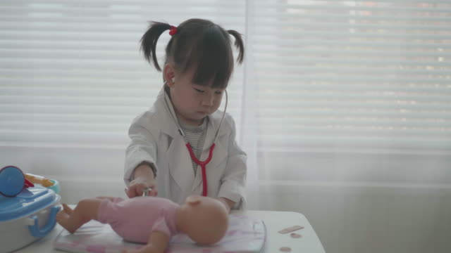toddler baby girl pretend playing as a doctor at home - small stock videos & royalty-free footage