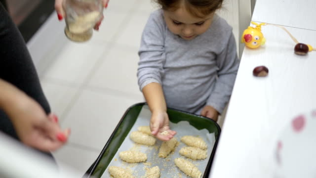 Toddler baking with mother