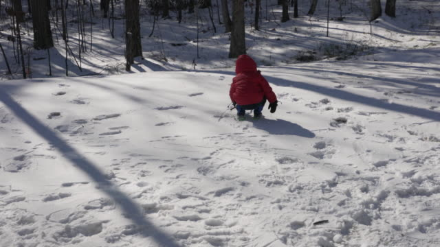 toddler boy drawing in the snow with a stick - wide angle stock videos & royalty-free footage