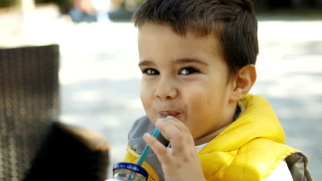Toddler boy drinking juice