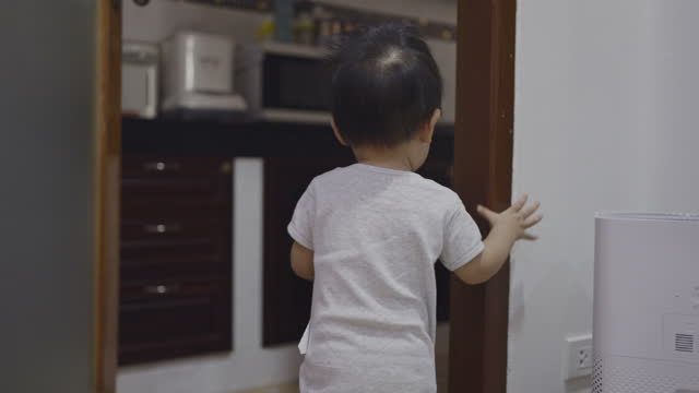 toddler boy followed his mother into the kitchen - following stock videos & royalty-free footage