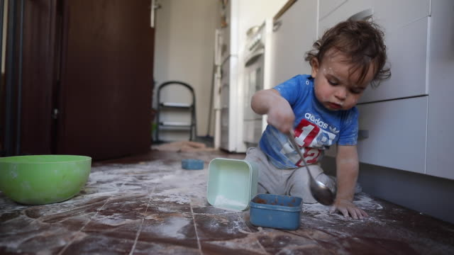 toddler boy having fun with flour at kitchen - messy stock videos & royalty-free footage