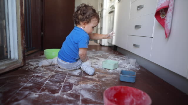 toddler boy making a mess with flour at kitchen - mischief stock videos & royalty-free footage
