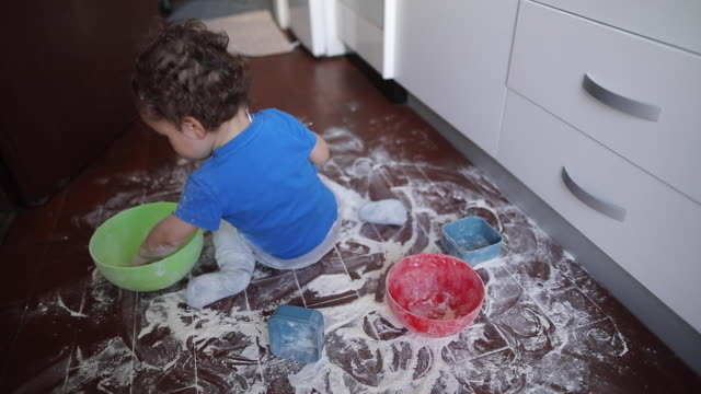 toddler boy making a mess with flour at kitchen - messy stock videos & royalty-free footage