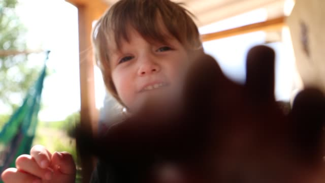 vídeos de stock, filmes e b-roll de toddler boy on porch - animal de brinquedo