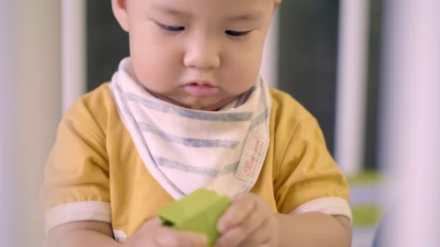 Toddler boy playing in crib