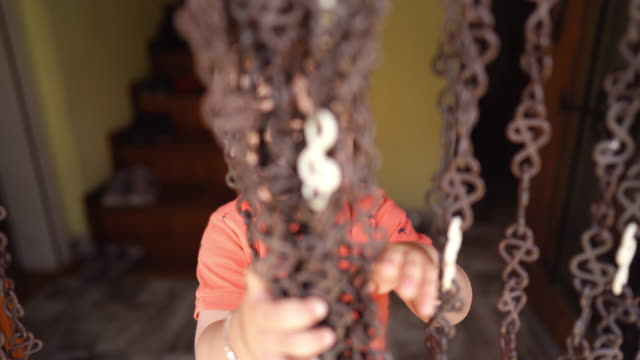 toddler boy playing with beaded curtain - beaded curtain stock videos & royalty-free footage
