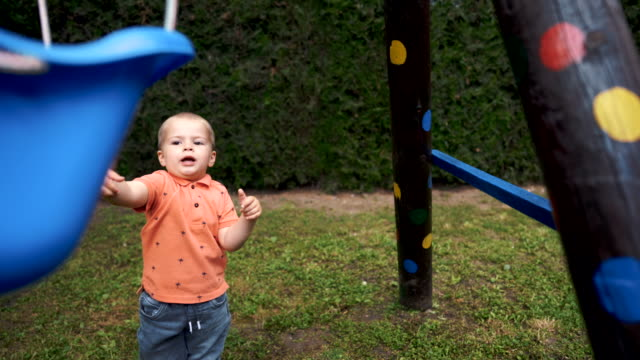 toddler boy playing with swing - swinging stock videos & royalty-free footage