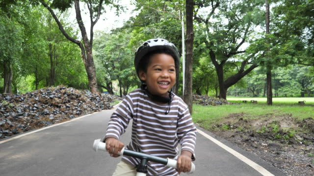 toddler boy riding scooter - cycling helmet stock videos & royalty-free footage