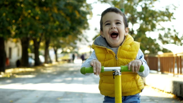 toddler boy riding scooter - toddler stock videos & royalty-free footage