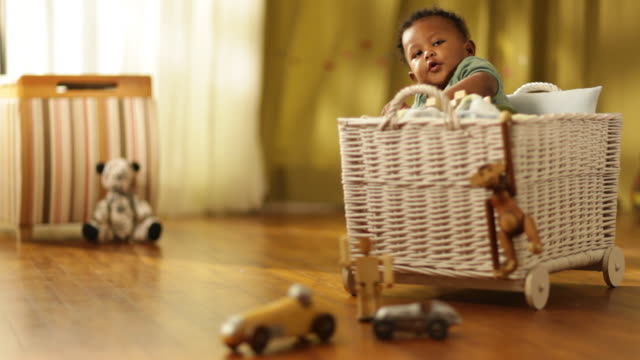 toddler boy sitting in rattan basket in kids room - wicker stock videos & royalty-free footage