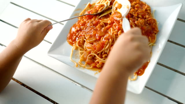 toddler child eating spaghetti. - spaghetti stock videos & royalty-free footage