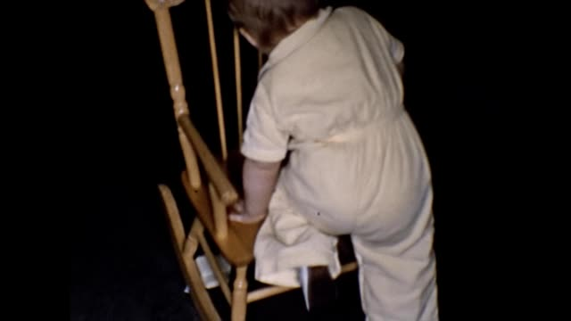 1955 Toddler Climbing Onto Rocking Chair