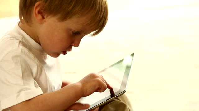 Toddler digital tablet, with a helping hand from mum.